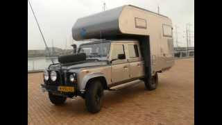 Landrover Defender 130 with a demountable pickup unit type dc 240 s by Dutch Campers outside